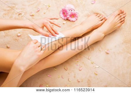 Woman waxing legs