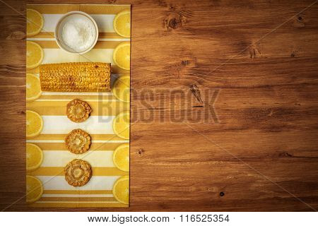 corn with salt on cloth and on wooden texture