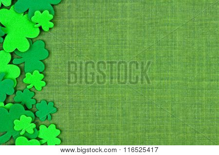 St Patricks Day side border of shamrocks over green linen