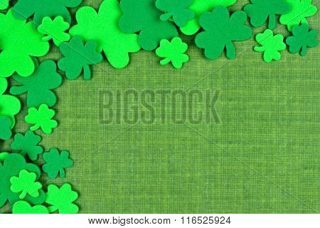St Patricks Day corner border of shamrocks over green linen