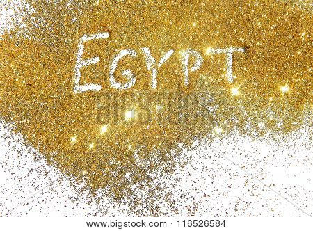 Inscription Egypt on golden glitter sparkle on white background