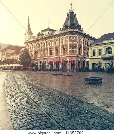 central square in Kosice with tram rails after rain