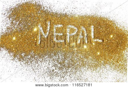 Inscription Nepal on golden glitter sparkle on white background