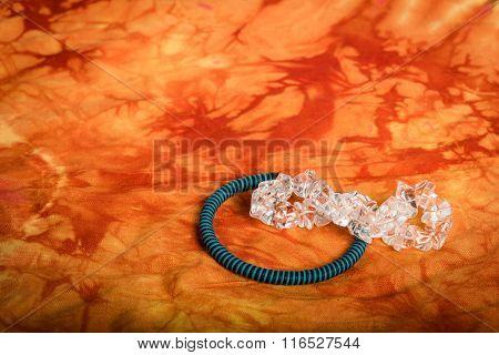 Two Bracelets On A Fabric