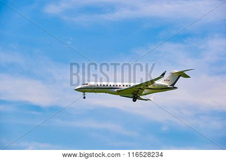 HONG KONG - JUNE 04, 2015: The Bombardier Global Express aircraft landing at Hong Kong airport. The Bombardier Global Express is a large cabin, ultra long range business jet.