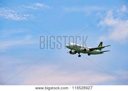 HONG KONG - JUNE 04, 2015: Spring Airlines aircraft landing at Hong Kong airport. Spring Airlines is a low-cost carrier with its headquarters in the Homeyo Hotel in Changning District, Shanghai, China