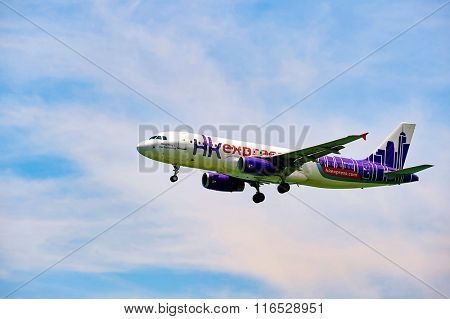 HONG KONG - JUNE 04, 2015: HK Express aircraft landing at Hong Kong airport. HK Express is a Hong Kong-based low-cost airline