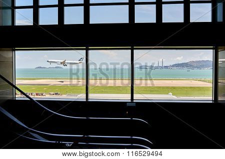 HONG KONG - JUNE 04, 2015: Cathay Pacific aircraft landing at Hong Kong airport. Cathay Pacific is the flag carrier of Hong Kong