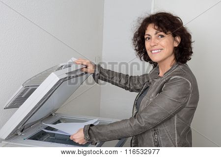 Attractive Business Woman Working On Office Printer Machine