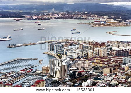 an aerial view of Gibraltar, its marina and the Mediterranean sea as seen from the Rock of Gibraltar