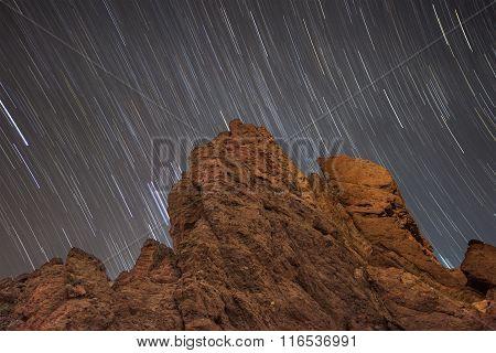 Star trails over Roque de Garcia in Teide national park Tenerife Canary island Spain.