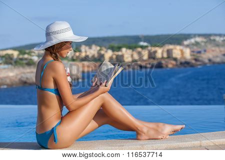 summer holiday in mallorca woman reading book