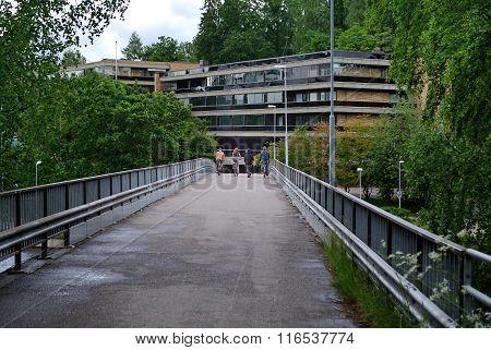 Bicyclists on the bridge.