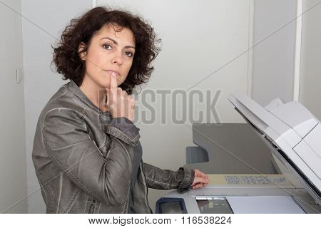 business woman at the copy machine