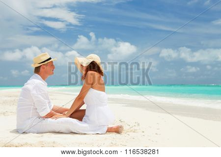 Happy couple on the beach of sea