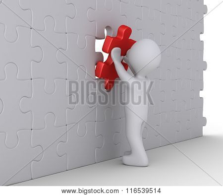 Person Is Completing Wall Puzzle