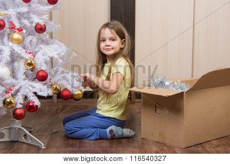 Funny Girl Takes Off A Christmas Tree With Toys