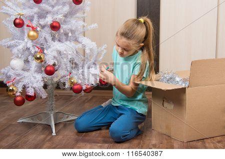 Girl Shoots Balls With Christmas Tree