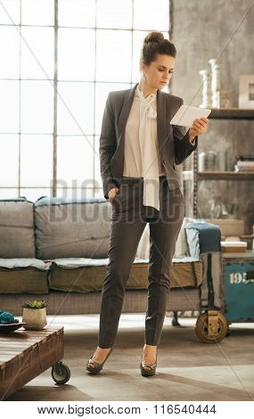 Elegant Business Lady Holding Pc Tablet In Loft Apartment