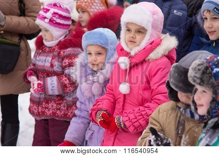 Two Little Girls Standing In A Crowd Of Children On The Childrens New Years Celebration In The Stree