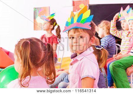 Portrait of a boy wearing Indian headwear in class