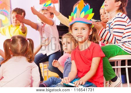Girl portrait among kids in kindergarten class