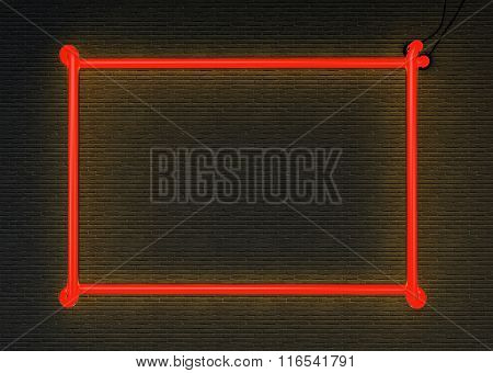 Red neon frame isolated on black brick wall background