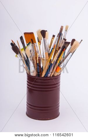 Brushes on the tin can