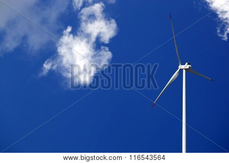 Wind Turbine And Blue Sunlight Sky