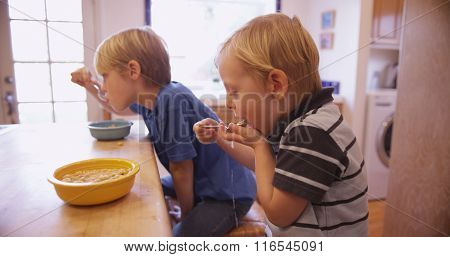 Little Young Boy Eating Cereal With His Brother