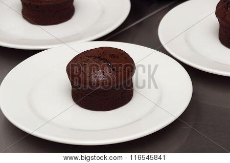 Chocolate Fondant Cake On A White Plate