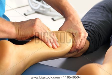 Rehabilitation clinic. Massage calf