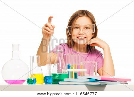 Young pupil studying chemistry in the laboratory