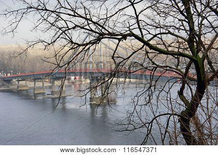 Kind Of A Long Pedestrian Bridge Over A Large River