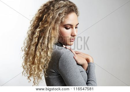 Woman With A Blond Curly Hair