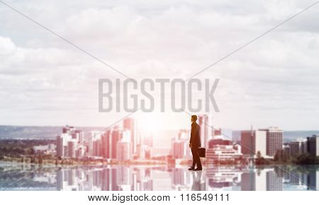 Businessman facing new day
