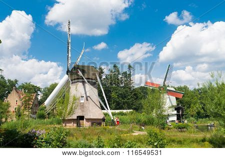 ARNHEM NETHERLANDS - JULY 26 2015: Classic windmills in the Netherlands Open Air museum. The museum shows the Dutch history from an everyday perspective