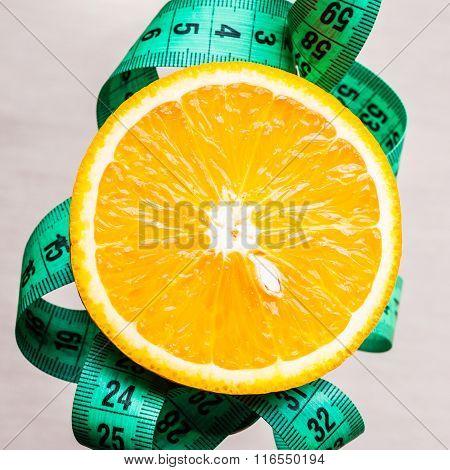 Green Measuring Tape And Orange Fruit