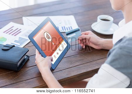 Web against businesswoman using tablet pc and holding credit card
