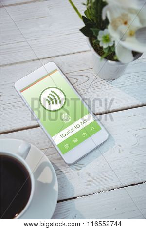 Web against smartphone on table