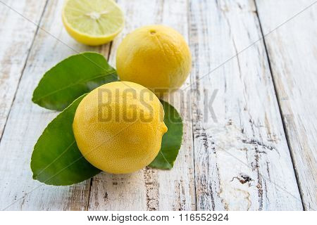 Fresh Lemon On White Wooden Table