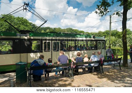 People Waiting For Tram