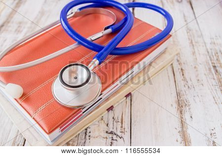 Stethoscope On Book On Wooden Table