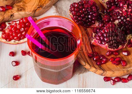 Pomegranate Juice  And Ripe Red Pomegranate