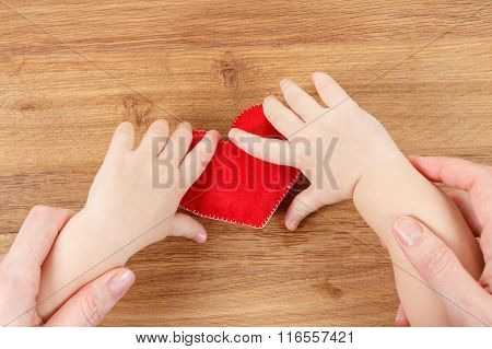 Hands Of Mother And Son Holding Heart Symbol