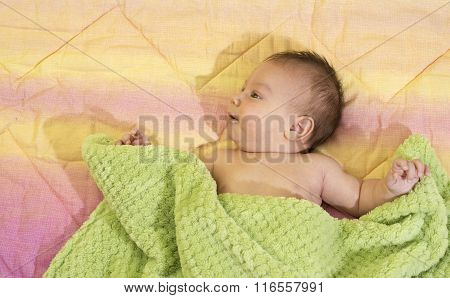 Portrait Of A Newborn Baby Boy In Bed