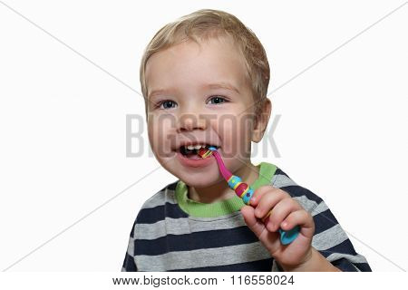 Baby With White First Teeth Brushing Teeth With A Toothbrush. White Little Boy With A Toothbrush In