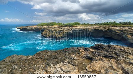 Surf at rocks on coastline