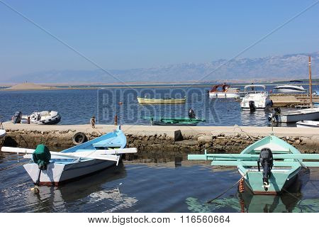 Mediterranian seaside view with boats and piers