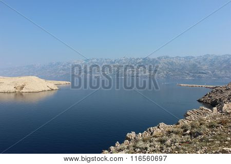 Mediterranian seaside view with rocky mountains and lighthouse